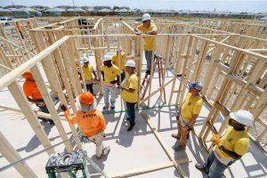 overhead shot of volunteers working on house